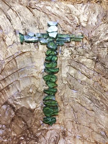 Emerald green glass crucifix framed gold