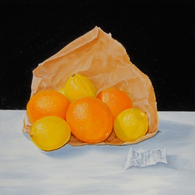 Navel oranges with lemons in a brown paper bag