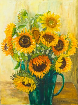 Sunflowers in a green jug