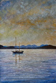 A boat in a tranquil sunset scene.