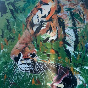 Burning bright, Bengal tiger prowling through the forest