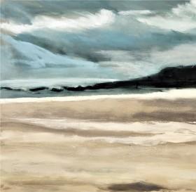 late summer light on a large beach with headland under cloudy sky